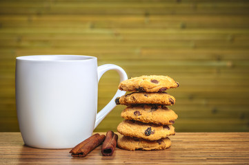 White cofee cup with batch of cookies