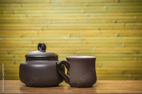 Cup and bowl on bamboo background