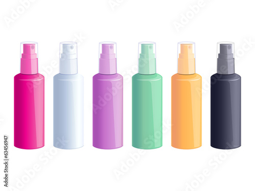 Set of colorful spray bottles on white background.