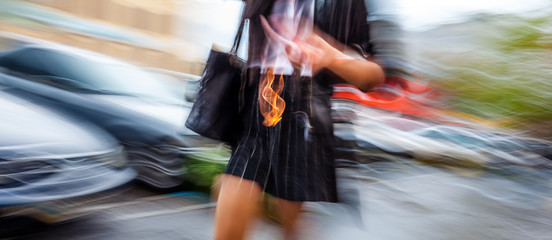 Abstract image of a woman walking down the street