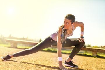 Young woman preparing to run