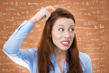 Confused woman isolated on chalkboard filled with formulas