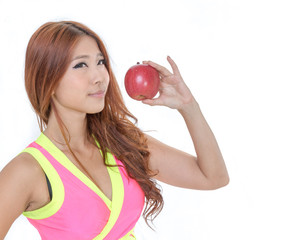 Beautiful fit Chinese woman holding an apple