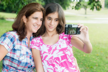 Teen and her young mother taking a self picture