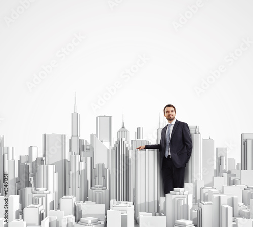 Businessman and model of a city