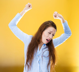 Sleepy yawning woman isolated on yellow background