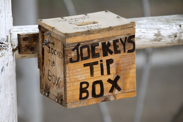 Jockeys tip box a wooden box for collecting gratuities