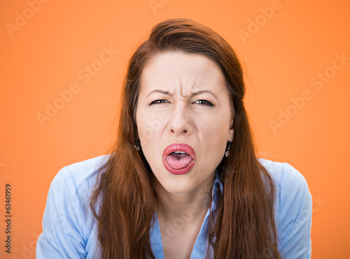 Unhappy woman sticking her tongue out