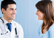 Portrait of smiling doctor and female patient