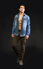 Young man wearing denim shirt open on naked chest