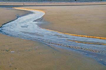 Creek on a beach at ebb tide