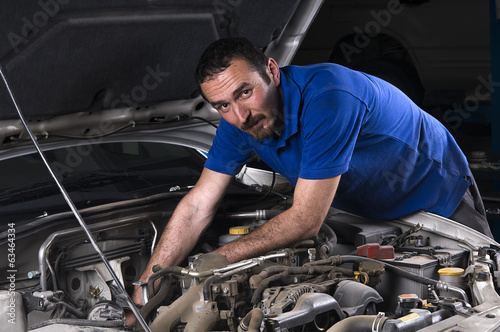 Mechanic looking at camera
