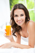 canvas print picture - Happy woman drinking juice