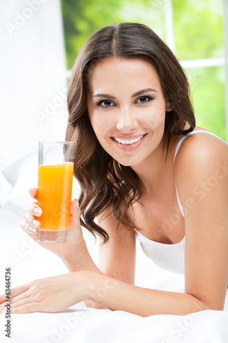 canvas print picture Happy woman drinking juice