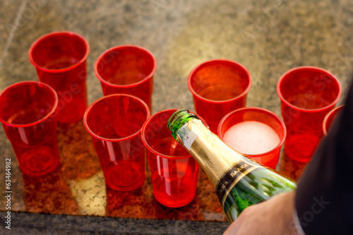 Red plastic cups with champagne