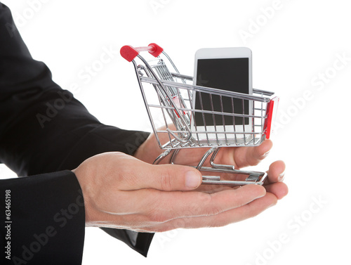 Businessman holding a shopping cart