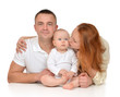 Young family mother and father with newborn child baby girl