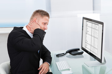 Businessman studying an online spreadsheet