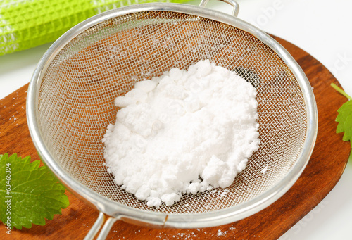 Powdered sugar in a sieve