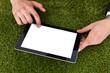 Businessman Using Digital Tablet On Grass
