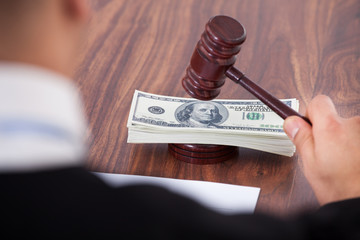 Judge Hitting Mallet On Banknotes