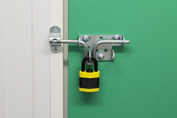 Black and Yellow Padlock on self storage unit