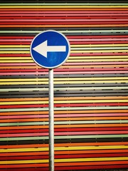 road-sign on multicolored  strips background
