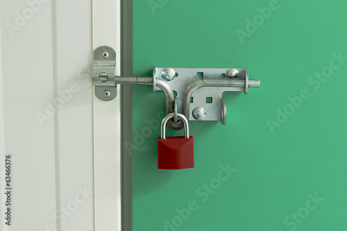 Red Padlock on self storage unit