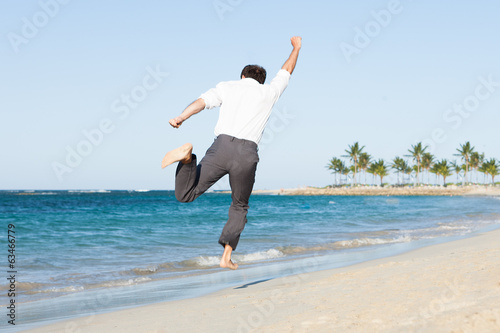 Man Jumping At Beach
