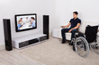 Handicap Man Watching Television In Living Room
