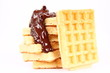 Waffles covered with chocolate on a white background