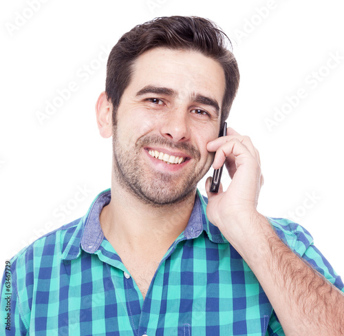 Handsome latin man talking on cell phone, isolated on a white ba