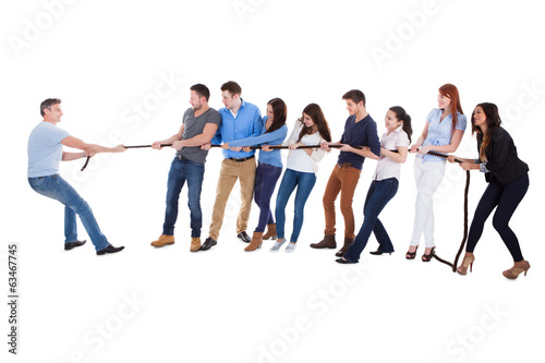 Group of people having a tug of war