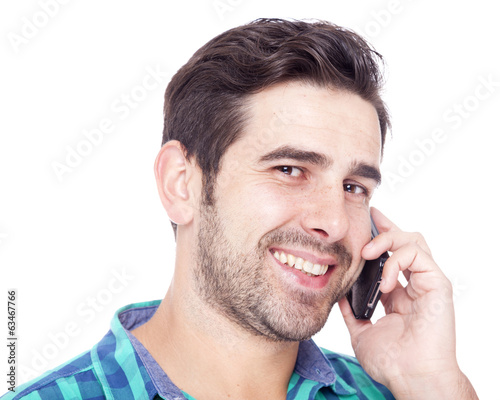 Thoughtful latin man talking on cell phone, isolated on a white
