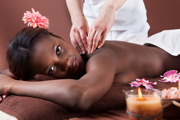 Woman Receiving Shoulder Massage At Spa