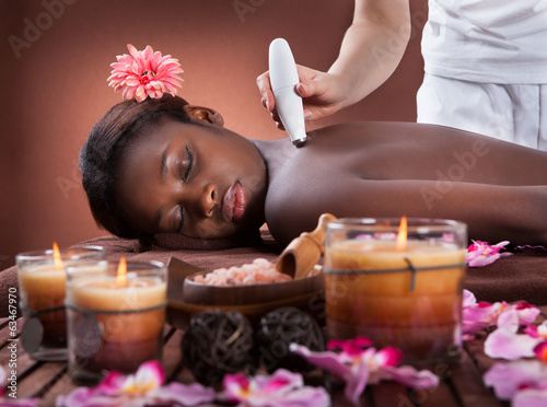 poster of Woman Undergoing Microdermabrasion Therapy At Spa