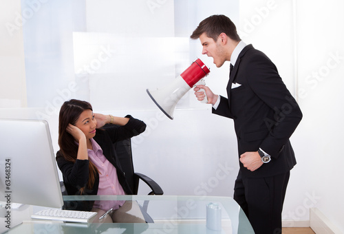 Businessman Scolding Businesswoman
