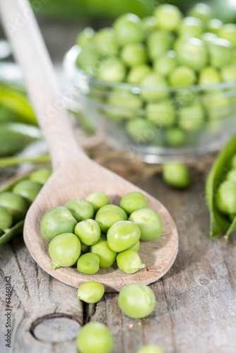 Fresh Peas on a cooking spoon