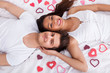 Young Couple Lying On Mattress