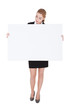 Businesswoman Holding Placard