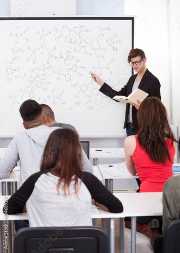 Teacher Teaching Chemical Formulas To College Students