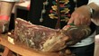 Cutting the Croatian Dry Ham