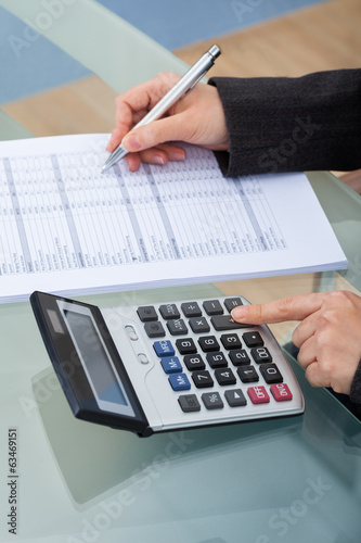 Businesswoman Calculating Tax
