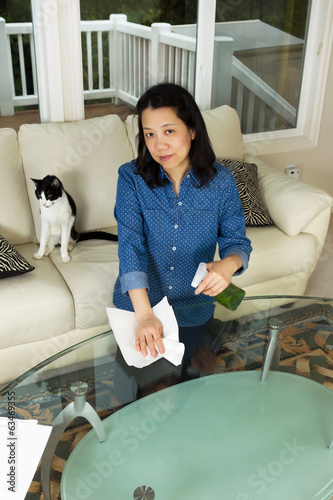 Mature woman preparing to clean table
