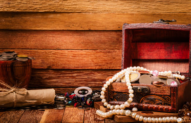 Open wooden treasure chest with valuables