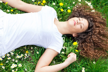 beautiful woman sleeping with flowers outdoor