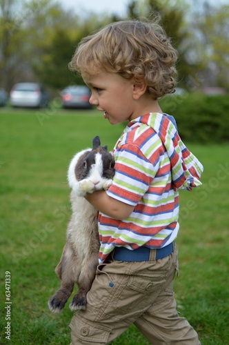 child with rabbit