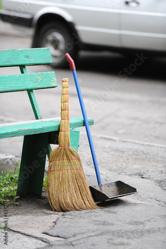 broom, scoop and bench