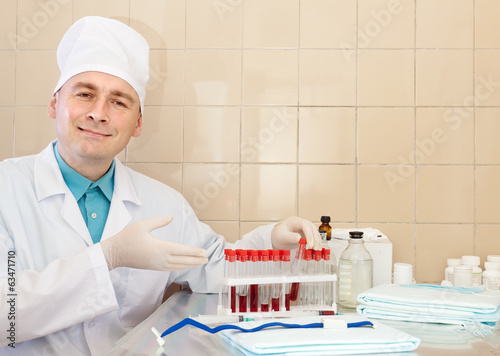 male nurse works with blood sample