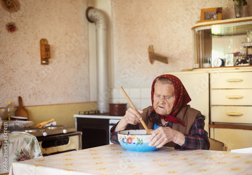 Old woman in the kitchen